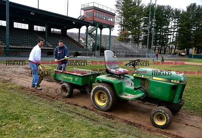 4/5/2017 Mike Orazzi | Staff Bristol Parks & Recreation employees Dean Dionne and Brian Beaudoin prepare Muzzy Field for the spring sports season on Wednesday morning.