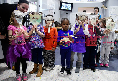 4/6/2017 Mike Orazzi | Staff Children hold up masks during the Grand Opening of the Playbox Theater Studio at the Imagine Nation, a Museum Early Learning Center, Thursday morning.