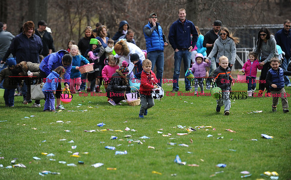 4/7/2017 Mike Orazzi | Staff Children scramble for candy during the Berlin Parks and Recreation Department's annual Easter Candy Hunt Saturday afternoon.