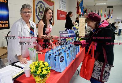 4/7/2017 Mike Orazzi | Staff Bristol Hearing Aids' Joanne Cyr-Callaghan and Myranda LaPira talk with Judith Ostroski during The Bristol Press & New Britain Herald and Connecticut Prime Time's 3rd Annual Senior Fair held at Bristol Eastern High School Saturday.