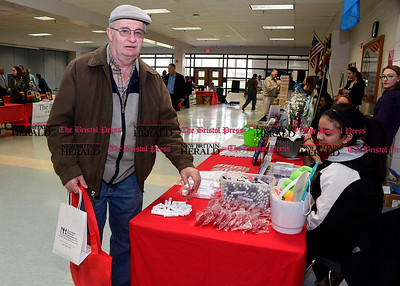 4/7/2017 Mike Orazzi | Staff Joe Chilstrom stops at the Countryside Manor table staffed by Deana Prowell during The Bristol Press & New Britain Herald and Connecticut Prime Time's 3rd Annual Senior Fair held at Bristol Eastern High School Saturday.