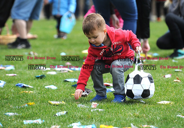4/7/2017 Mike Orazzi | Staff Jackson Mowel scrambles for candy during the Berlin Parks and Recreation Department's annual Easter Candy Hunt Saturday afternoon.
