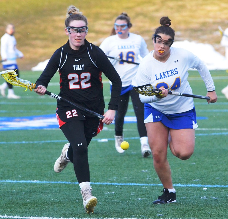 . John Brewer - Oneida Daily Dispatch Cazenovia�s Chloe Willard, left, and Tully�s Gemma Guy vie for a ball during Tuesday�s girls lacrosse tilt. Cazenovia walked away with an 11-8 win.