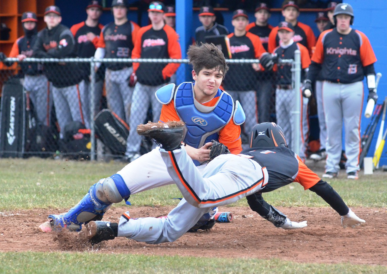 John Brewer - Oneida Daily Dispatch Oneida catcher Jorden Barlow tags out Rome Free Academy's Alex Sticca at home plate during Oneida's 10-7 win on Friday, April 20.
