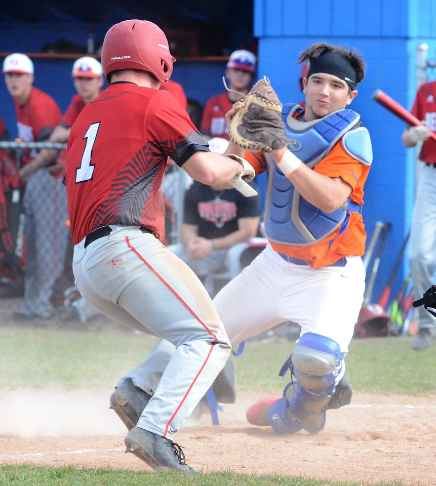 John Brewer - Oneida Daily Dispatch Oneida catcher Jorden Barlow prepares for a tag on VVS' Tyler Rotach during play on Tuesday, April 24.