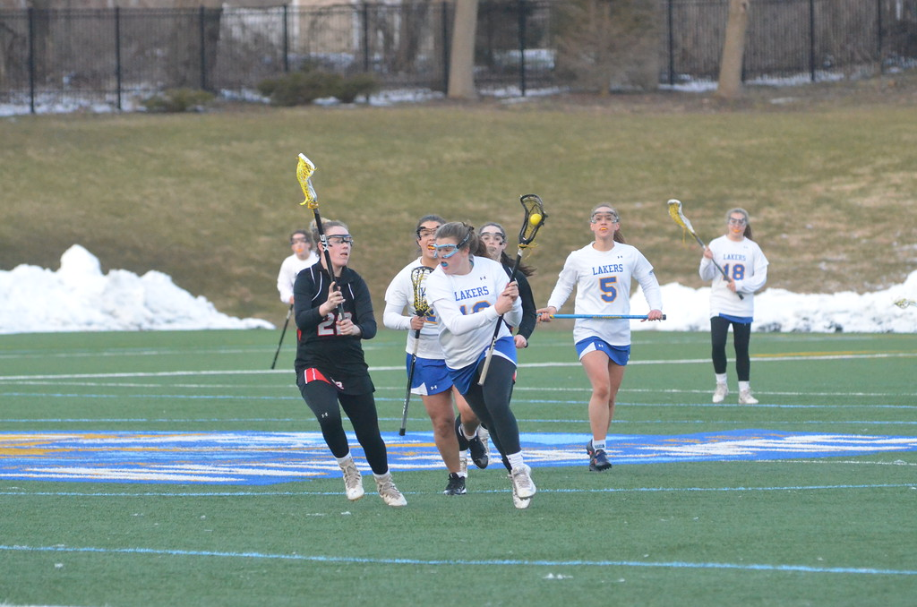 . John Brewer - Oneida Daily Dispatch Cazenovia�s Grace Rajkowski carries the ball past a Tully defender on Tuesday, April 12.
