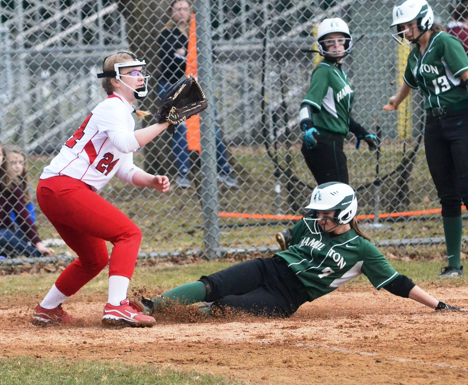 . John Brewer - Oneida Daily Dispatch Hamilton�s Madison Rodriguez slides home safely while Morrisville-Eaton pitcher Amy Jacobs covers home plate during a 16-2 Hamilton win on Friday, April 13.