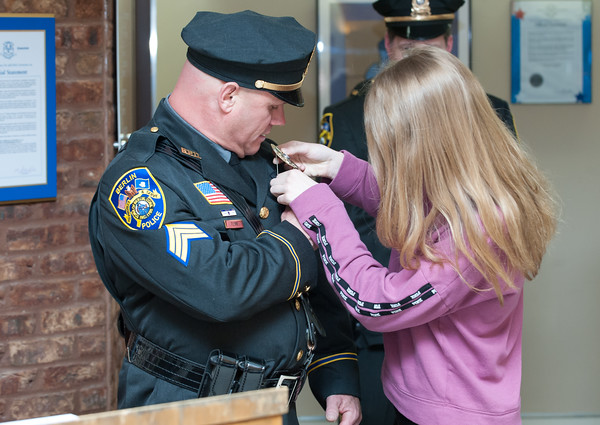 04/02/18 Wesley Bunnell | Staff The Berlin Police held a promotion ceremony on April 2nd at town hall for the newly appointed Lt. Michel Jobes and Sgt. John Flynn. Sgt. Flynn has his badge pinned to his uniform by his daughter Jessica.