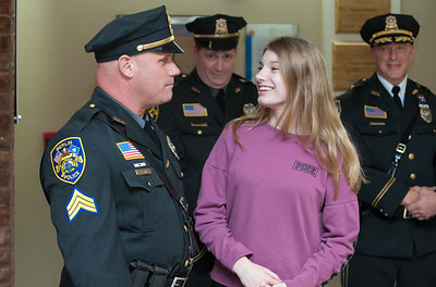 04/02/18  Wesley Bunnell | Staff  The Berlin Police held a promotion ceremony on April 2nd at town hall for the newly appointed Lt. Michel Jobes and Sgt. John Flynn.  Jessica Flynn smiles at her father Sgt. John Flynn after pinning his badge to his uniform.