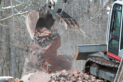 04/02/18  Wesley Bunnell | Staff  Demolition of a house adjacent to Kensington Congregational Church started on Monday which is the first step in an expansion to the church property.  The final corner of the garage is toppled by an excavator.