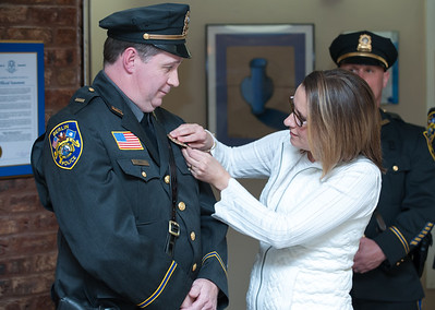 04/02/18  Wesley Bunnell | Staff  The Berlin Police held a promotion ceremony on April 2nd at town hall for the newly appointed Lt. Michel Jobes and Sgt. John Flynn. Lt. Jobes has his badge pinned to his uniform by his wife Diane.