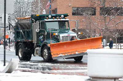 04/02/18  Wesley Bunnell | Staff  A plow truck drives through a snowy Main St in New Britain on Monday afternoon.