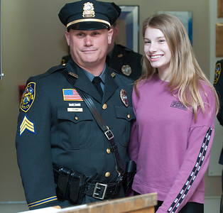 04/02/18  Wesley Bunnell | Staff  The Berlin Police held a promotion ceremony on April 2nd at town hall for the newly appointed Lt. Michel Jobes and Sgt. John Flynn.  St. Flynn poses for a photo with daughter Jessica after she pinned his new badge on his uniform.