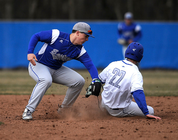 4/5/2018 Mike Orazzi | Staff Bristol Eastern High School's Matt D'Amato (2) as Plainville's Brady Callahan (22) slides safely into second base Thursday afternoon in Plainville.