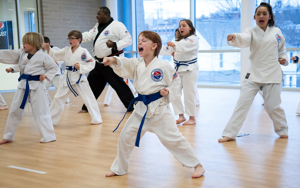 04/09/18 Wesley Bunnell | Staff The Martial Arts Program at the Bristol Boys and Girls Club for ages 7 and up meets every Monday at 5:45. Annie Hayman, age 8, middle, in practice with Maya Gonzalez, R, and instructor Alex Calderon in the background.