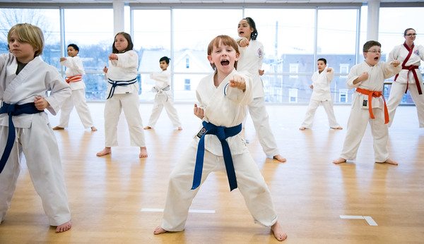 04/09/18 Wesley Bunnell   Staff The Martial Arts Program at the Bristol Boys and Girls Club for ages 7 and up meets every Monday at 5:45. Annie Hayman, age 8, middle, practices middle punch from a horse stance.