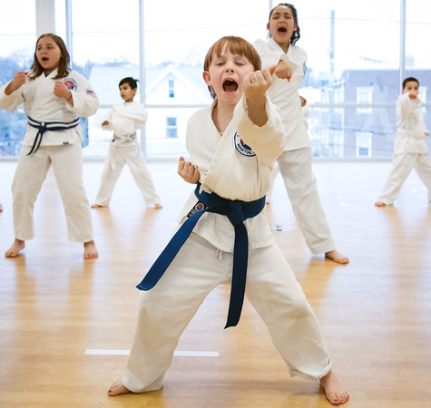 04/09/18 Wesley Bunnell | Staff The Martial Arts Program at the Bristol Boys and Girls Club for ages 7 and up meets every Monday at 5:45. Annie Hayman , age 8, practices middle punch from a horse stance.