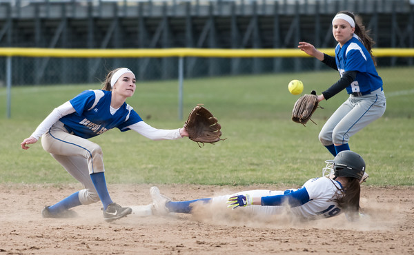 04/09/18 Wesley Bunnell | Staff Southington softball defeated Bristol Eastern 6-1 at Southington High School on Monday afternoon. Jordan Fitzsimons (10) and Taylor Keegan (6)