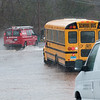 04/16/18  Wesley Bunnell | Staff<br /> <br /> A DATTCO school bus stuck in flood water at Willow Brook Park as other vehicles attempt to make their way around it on Monday afternoon.