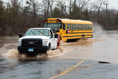 04/16/18  Wesley Bunnell | Staff  A DATTCO fleet vehicle pulls a school bus which was stuck for approximately 20 minutes out of the floodwater at Willow Brook Park on Monday afternoon.