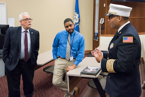 04/11/18 Wesley Bunnell | Staff New Fire Chief Raul Ortiz held an open session to meet the public from 5-7pm at the New Britain High School lecture hall on Monday. Chief Ortiz, R, speaks with Alderman Daniel Salerno.