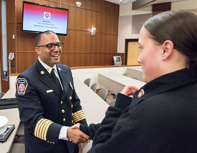 04/11/18  Wesley Bunnell | Staff  New Fire Chief Raul Ortiz held an open session to meet the public from 5-7pm at the New Britain High School lecture hall on Monday. Chief Ortiz shakes hands with Innovation High School student Adrianna Baez.