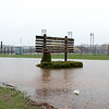 04/16/18  Wesley Bunnell | Staff<br /> <br /> Flood water streams past the entrance sign to Willow Brook Park on Monday afternoon.