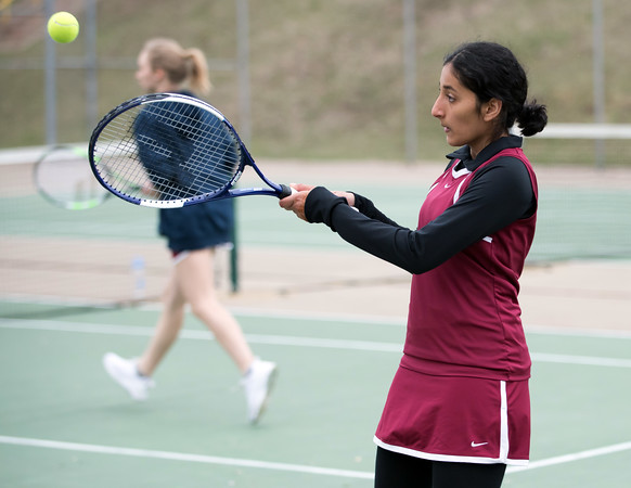 04/17/18 Wesley Bunnell | Staff Berlin girls tennis at New Britain on Tuesday afternoon. Playing doubles for New Britain are Danya Alboslani, R, and Zoe Hayres.