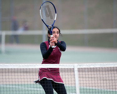 04/17/18  Wesley Bunnell | Staff  Berlin girls tennis at New Britain on Tuesday afternoon. New Britain's Danya Alboslani.
