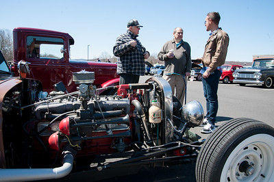 04/21/18  Wesley Bunnell | Staff  Car owner Augie Reil, L, speaks with Nick Carroll and Luke Stroehlein in front of his 1940 Dodge truck at the Klingberg Family Center. The Klingberg Vintage Motorcar Series held their April event on Saturday with a focus on the Ford Model A.
