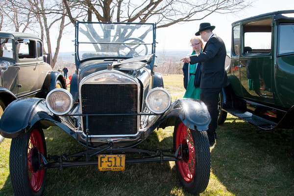 04/21/18 Wesley Bunnell | Staff Brandon Barriello points out features on a vintage Ford to Rebecca Nowak at the Klingberg Family Center. The Klingberg Vintage Motorcar Series held their April event on Saturday with a focus on the Ford Model A.