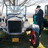 04/21/18  Wesley Bunnell | Staff<br /> <br /> Brandon Barriello points out features on a vintage Ford to Rebecca Nowak at the Klingberg Family Center. The Klingberg Vintage Motorcar Series held their April event on Saturday with a focus on the Ford Model A.