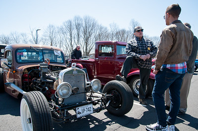 04/21/18  Wesley Bunnell | Staff  Car owner Augie Reil, L, speaks with  Luke Stroehlein, middle and Nick Carroll in front of his 1940 Dodge truck at the Klingberg Family Center. The Klingberg Vintage Motorcar Series held their April event on Saturday with a focus on the Ford Model A.