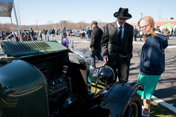 04/21/18 Wesley Bunnell | Staff Brandon Barriello and Rebecca Nowak examine the front end of a 1927 Rolls Royce Phantom I owned by Ernest Smith of Simsbury at the Klingberg Family Center. The Klingberg Vintage Motorcar Series held their April event on Saturday with a focus on the Ford Model A.