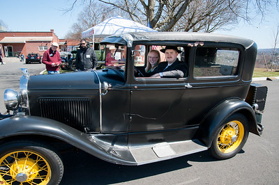 04/21/18  Wesley Bunnell | Staff  Brandon Barriello drives his 1930 Ford Model A accompanied by Rebecca Nowak out of the parking lot at Klingberg Family Centers. The Klingberg Vintage Motorcar Series held their April event on Saturday with a focus on the Ford Model A.