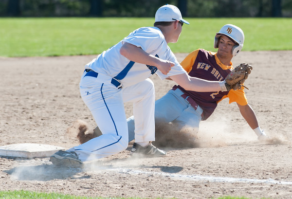 04/23/18 Wesley Bunnell | Staff New Britain baseball defeated Southington 9-8 in extra innings on Monday afternoon in a contest played at Southington High School. Justin Adorno (2) slides safely into third.
