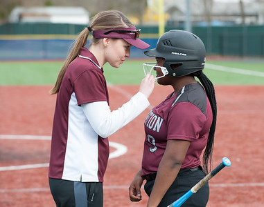 04/24/18  Wesley Bunnell | Staff  Innovation softball defeated Plainville 7-6 in extra innings on Tuesday afternoon at Plainville. Assistant coach Margaret Fallon gives advice during a time out to Serena Suarez.