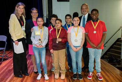 04/25/18  Wesley Bunnell | Staff  The Consolidated School District of New Britain held its District Middle School Spelling Bee Championship at Slade Middle School on Wednesday evening. Spelling Bee Master Lara Bohlke, L back row, Superintendent of Schools Nancy Sarra, Chief Operations Officer Paul Salina, R.  Winner Augustina Bounyarath from HALS front L and the rest of the 6th grade contestants.