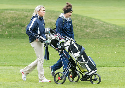 04/30/18  Wesley Bunnell | Staff  Newington girls golf vs New Britain on Monday afternoon at Indian Hill Golf Club in Newington.  Newington's Chloe Bilodeau and Jessica Pierschalski walk down the first fairway.
