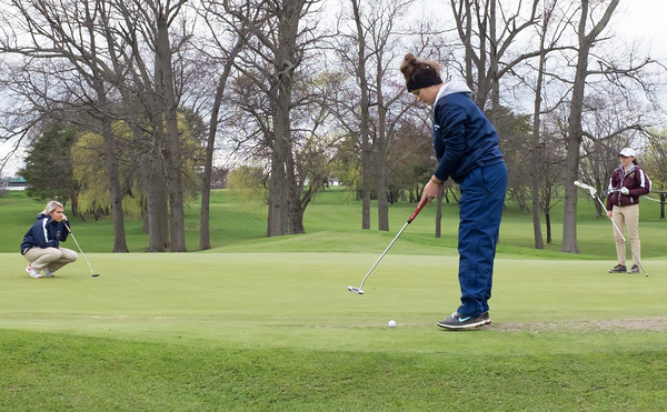 04/30/18 Wesley Bunnell | Staff Newington girls golf vs New Britain on Monday afternoon at Indian Hill Golf Club in Newington. Newington's Jessica Pierchalski readies to putt on the first green as teammate Chloe Bilodeau, L, and New Britain's Cate Keithline look on.