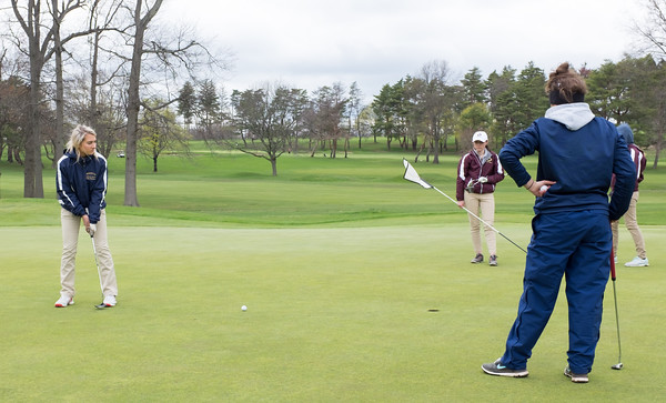 04/30/18 Wesley Bunnell | Staff Newington girls golf vs New Britain on Monday afternoon at Indian Hill Golf Club in Newington. Newington's Chloe Bilodeau putts on the first green.