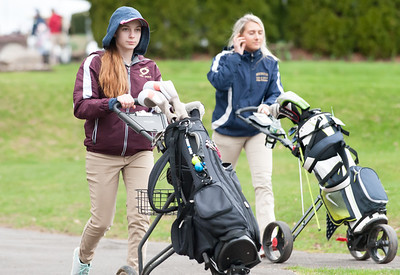 04/30/18  Wesley Bunnell | Staff  Newington girls golf vs New Britain on Monday afternoon at Indian Hill Golf Club in Newington.  New Britain's Kiley Griffin and Newington's Chloe Bilodeau walk off the first tee.