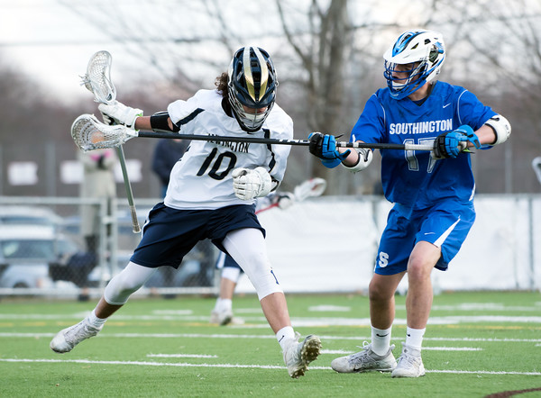 04/10/18 Wesley Bunnell | Staff Southington boys lacrosse defeated Newington 8-5 at Newington on Tuesday afternoon. Matt Bradley (10) and Eli Steindl (17)