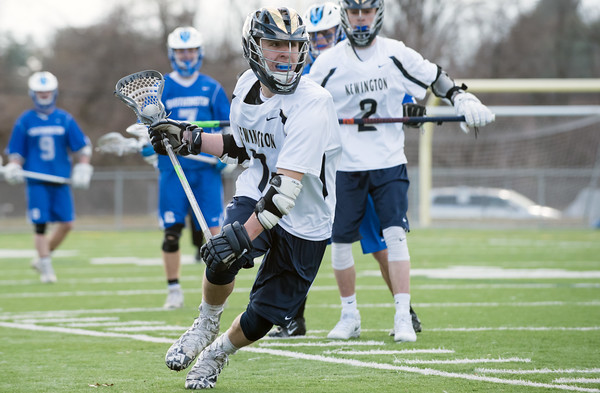 04/10/18 Wesley Bunnell | Staff Southington boys lacrosse defeated Newington 8-5 at Newington on Tuesday afternoon. Jordan Alexander (7).