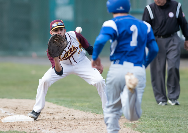 04/11/18 Wesley Bunnell | Staff New Britain baseball was defeated by Bristol Eastern on Wednesday afternoon at Beehive Field. Guillermo Burgos (3) receives the throw from the catcher for the out.