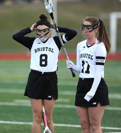 4/11/2018 Mike Orazzi | Staff Bristol Co-op lacrosse's Gabby Abramczyk (8) and Ashley MacDonald (11) at Bristol Central Wednesday.