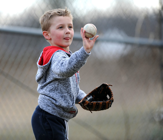 4/11/2018 Mike Orazzi | Staff Logan Annelli,6, while playing catch with his father Andrew at Bristol Central Wednesday.