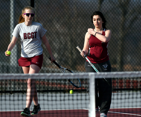 4/12/2018 Mike Orazzi | Staff Bristol Central's Michelle Helming and Erica O'Connor during Thursday's tennis match.