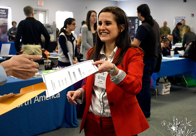 4/12/2018 Mike Orazzi | Staff Lincoln College's Jenifer Rahusen passes out information during the Lincoln College Career Fair held on campus Thursday.