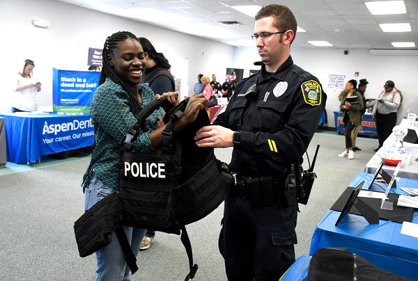 4/12/2018 Mike Orazzi | Staff Ebony Broadbell and Naugatuck Police officer Marc Robinson during the Lincoln College Career Fair held on campus Thursday.